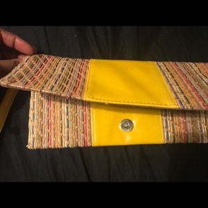 Yellow and striped straw clutch